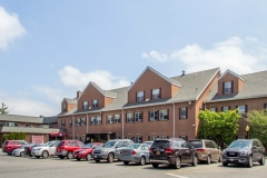 Dominican Village Buildings & Parking Area