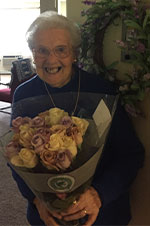 Marian Murnane a resident receiving flowers for Mothers Day 2017 at The Dominican Village through our Mothers Day Offer.