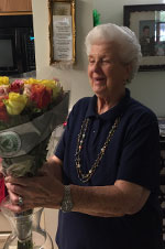 Jennie McGoldrick a resident receiving flowers for Mothers Day 2017 at The Dominican Village through our Mothers Day Offer.